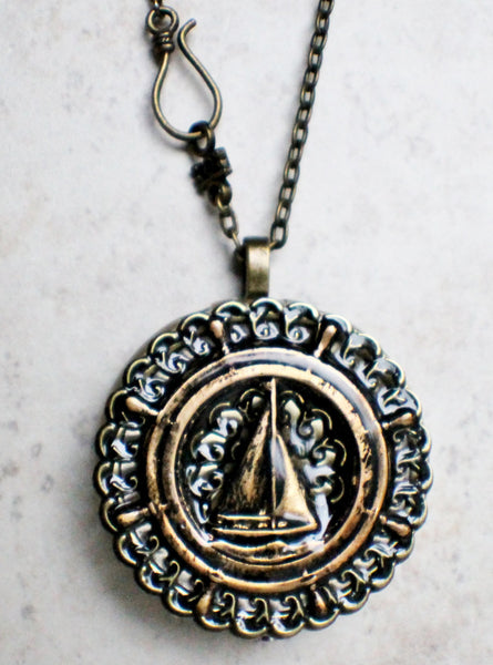 Music box locket, round bronze locket with music box inside, with a nautical theme featuring a sailboat on front cover. - Char's Favorite Things - 4