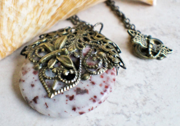 Crazy lace agate pendant, a round donut stone adorned with bronze filigree and dragonfly. - Char's Favorite Things - 2