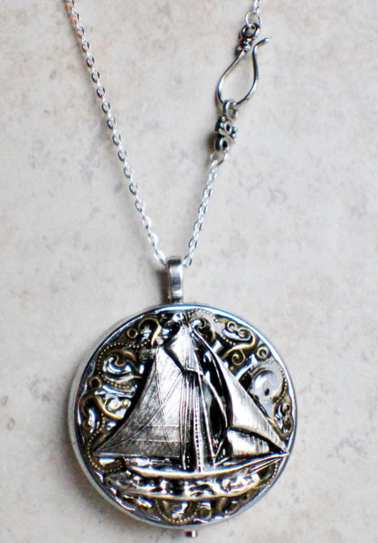 Music box locket, round silver tone locket with music box inside, with a nautical theme featuring a sailboat on front cover. - Char's Favorite Things - 4