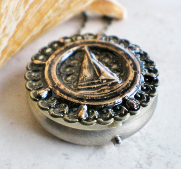 Music box locket, round bronze locket with music box inside, with a nautical theme featuring a sailboat on front cover. - Char's Favorite Things - 2
