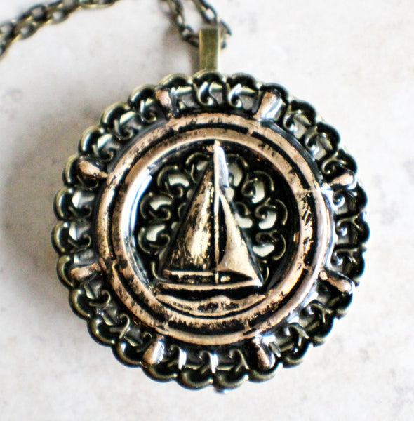 Music box locket, round bronze locket with music box inside, with a nautical theme featuring a sailboat on front cover. - Char's Favorite Things - 3