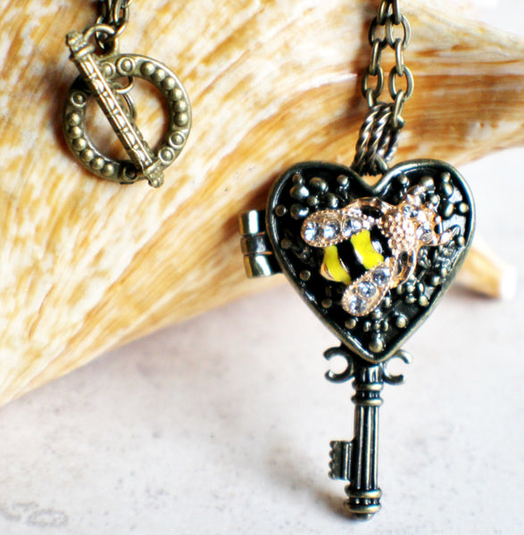 Bumble bee heart key photo locket, heart shaped bronze key locket with a bumble bee on front cover. - Char's Favorite Things - 1