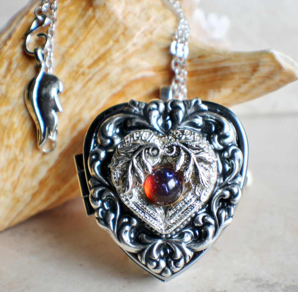 Music box locket, heart locket with music box inside, in silver tone with floral heart, angel wings and dragons breath opal cabochon. - Char's Favorite Things - 1
