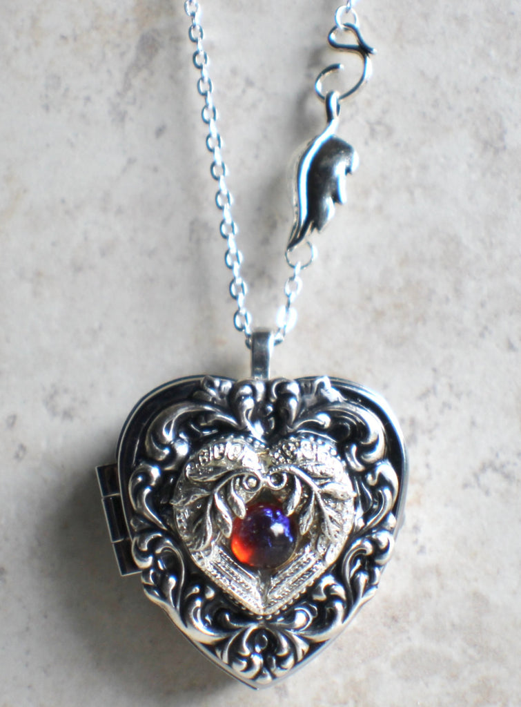 Silver angel wing locket chars favorite things music box locket heart locket with music box inside in silver tone with floral aloadofball