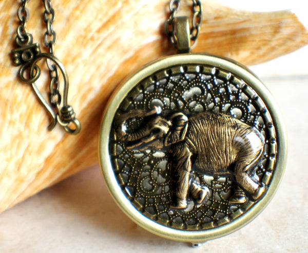 Elephant music box locket, round  locket with music box inside. - Char's Favorite Things - 1