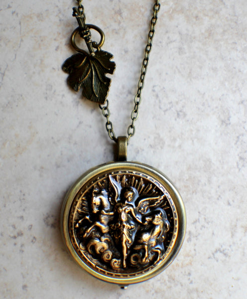 Angel and Horse Medalion Music Box Locket in Bronze. - Char's Favorite Things - 4