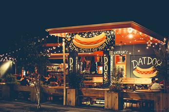 Night time view of the Gourmet Hot Dog restaurant, Dat Dog, in New Orleans.
