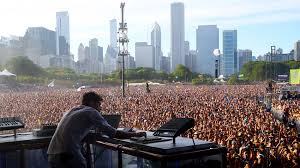 Dj overlooking the massive crowd (pre covid) at Lollapolooza in New York City.