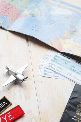 World map with a miniature plane