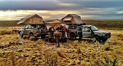 Group of friends caravaning and camping in phoenix, arizona.