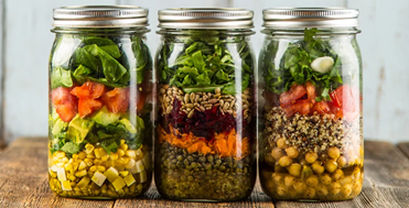 Premade salads in a glass jar perfect for a road trip