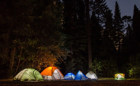 Beautiful image of tents glowing from lanterns during a warm spring night