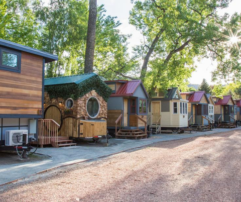 Group of unique tiny homes on a warm summers day