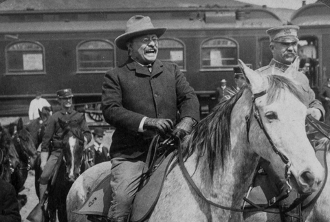 Teddy Rosevelt riding a horse through old American villages