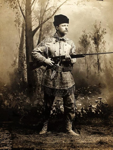Teddy Rosevelt posing with a rifle to show off his hunting skills.