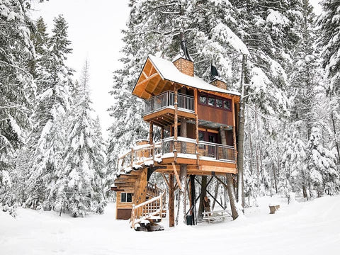 Breath Taking view of a snowy winter day in a tree house in columbia falls montana