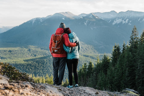 lovely couple overlooking a beautiful mountain view on a mid spring day.