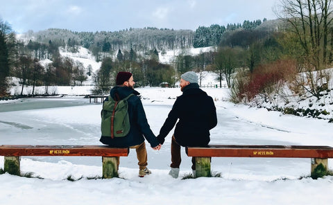 Happy couple enjoying a moment to themselves after a long day of skiing and snowboarding