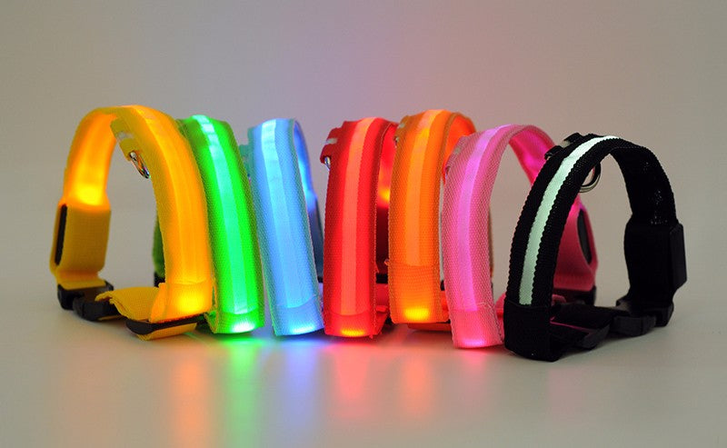 An image of yellow, green, blue, red, orange, pink, and black LED dog collars sold by Saint N Mike.