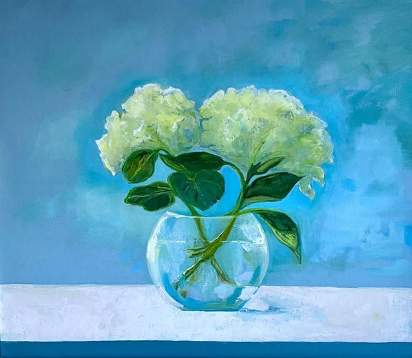 Oil painting by Anne Harney of two bunches of hydrangeas in a round glass vase against a blue backdrop