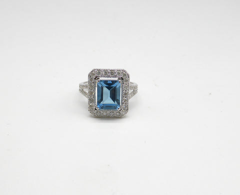 10K ladies blue topaz and diamond ring