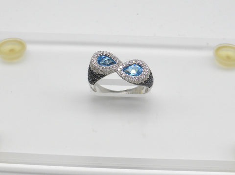 14K blue topaz, blue sapphire and diamond ring