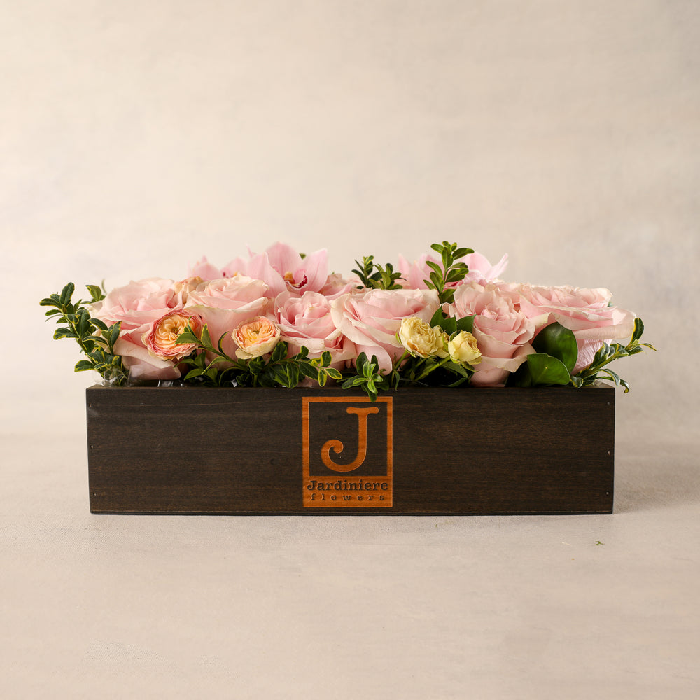 The Jardiniere Flowers Signature Flower Box Portsmouth New Hampshire Seacoast New England Florist Order Online for Local Delivery gorgeous flowers presented in a maine-in-maine wood box perfect present home business events just because happy birthday congratulations perfect gift thank you I love you Maine New Hampshire family-owned best local florist shown in pink colorful flowers roses orchids flower creation design customized support small business premium flowers