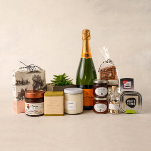 For the Home Gift Box by Jardiniere Flowers Luxe Veuve Cliqucot champagne succulent Noted. Candles Saipua soap honey tea jam Sarabeth's NYC Persephone Bakery cookie and granola family-owned florist Portsmouth New Hampshire celebrate love gifts wine flora Maine New Hampshire Seacoast of New England Local Delivery Order Online