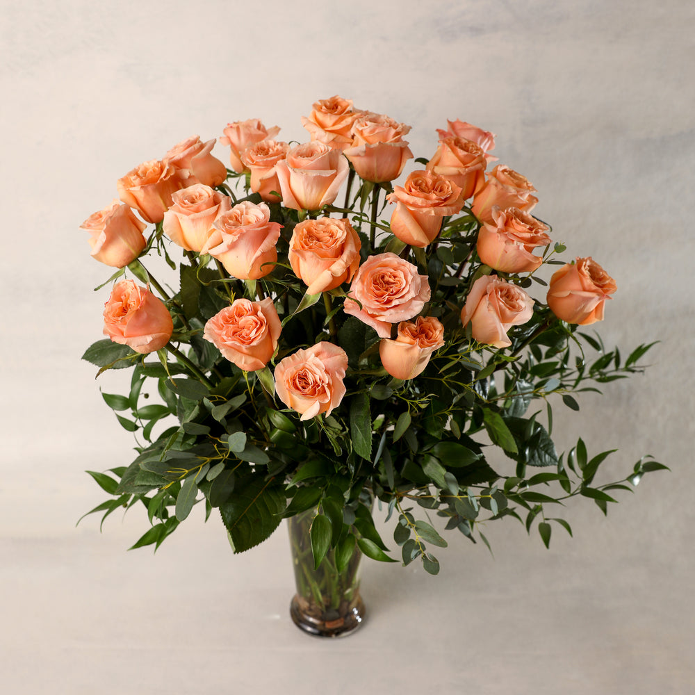 Two Dozen 24 Long Stemmed Roses Arranged in a Premium Vases beautiful greenery elegant classic Jardiniere Flowers Portsmouth New Hampshire Seacoast New England Family-owned florist order online for local delivery Maine New Hampshire love romance roses peach
