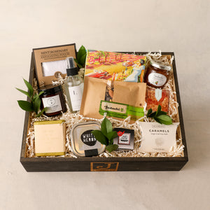 Signature Gift Box Line Standard Size by Jardiniere Flowers Portsmouth New Hampshire Gift Boxes Byrds Cookies Elizabeth W. exfoliating pouch, Sarabeth Jam, White Heron Tea, Lavande Farms Linen Spray, Tea ball infuser for loose leaf tea, body cream by Birchrose and Co, Saipua Soap, farm icelandic sheep, Sugarfina candy cube, McCrea's caramel Cape Cod Sea Salt, Fastachi Nuts assorted mixed nuts, corporate gifting, house warming, online ordering, florist in Seacoast New Hampshire local delivery Maine NH Maine