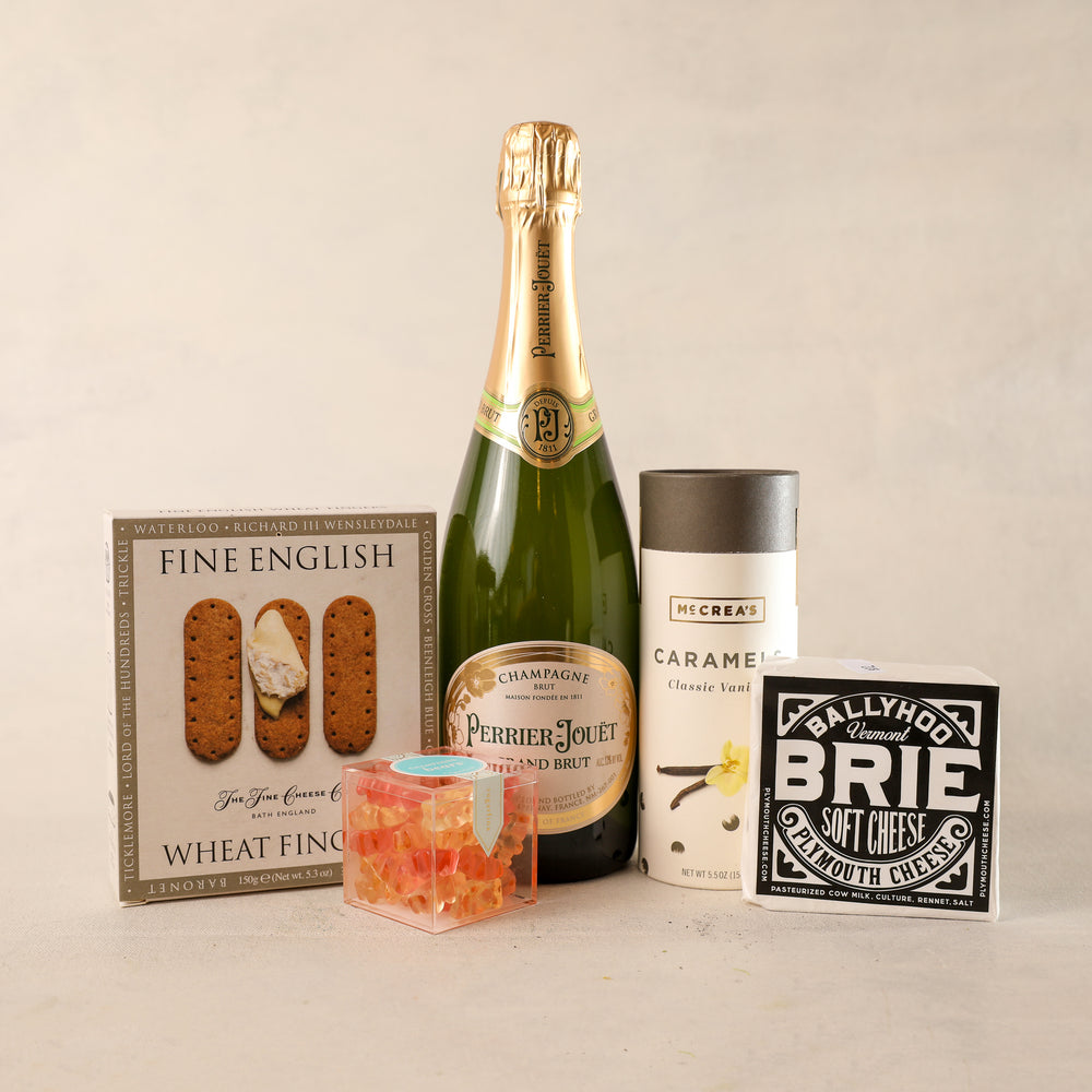 Champagne Large Gift Box for Gift Boxes by Jardiniere Flowers, Perrier-Jouet Champagne The Fine Cheese Company Wheat Fingers, Plymouth Cheese Vermont Plymouth Artisan Cheese Brie Sugarfina Candy Cube Champagne Bears McCreas Candies Caramel Tube Corporate Gifting House Warming Portsmouth New Hampshire New England Seacoast Florist Order Online for Local Delivery Products Maine New Hampshire