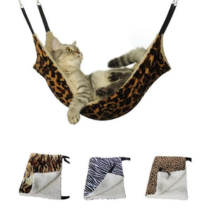 cat lying on a tiger print hammock pet bed with zebra and leopard ones shown underneath