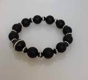 Orbit necklace in black onyx wrap your wrist with beauty.