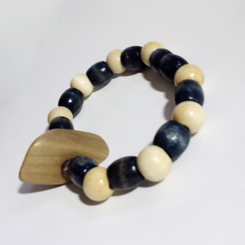 Lightweight and attractive beige and blue wood bracelet.
