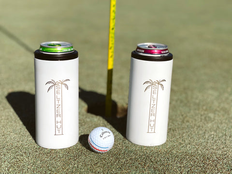 Two Seltzer Hut slim can insulators on Golf Course