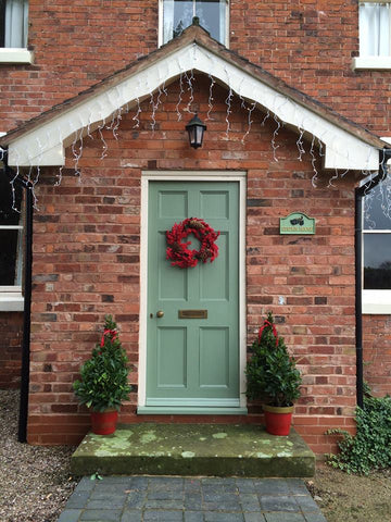 Christmas Front Door With Cast House Sign