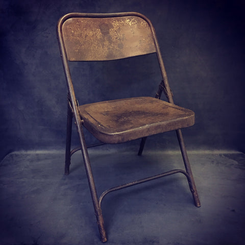 old metal folding chair