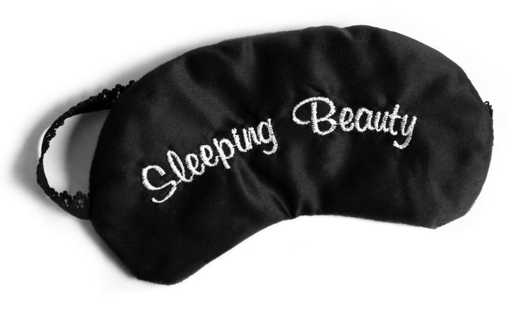 Black Sleeping Eye Mask with embroidered sleeping beauty stitched into silk material. Sleep eye mask with a black lace head band