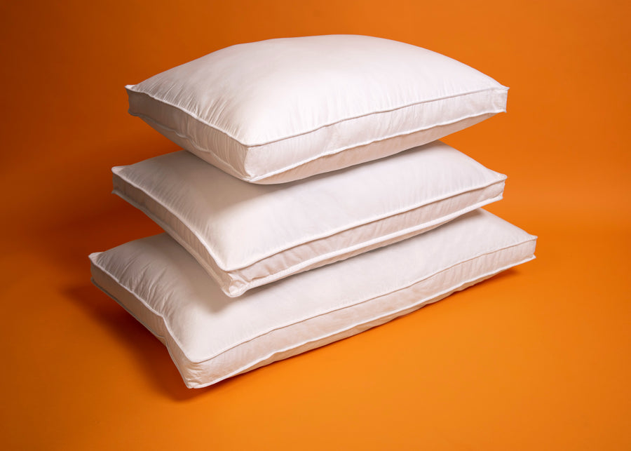 white down alternative polyester pillows stacked