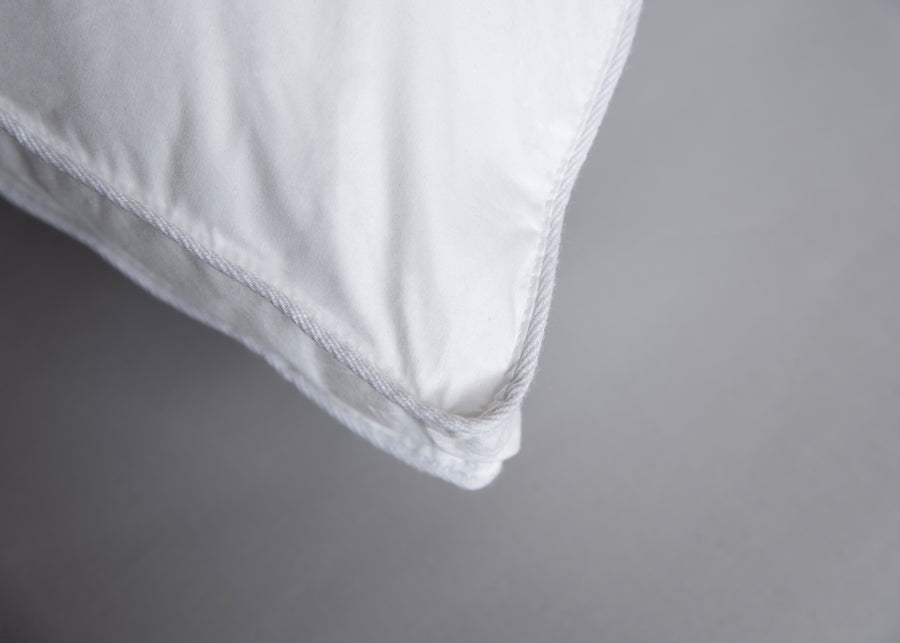 white gusseted  polyester pillow corner