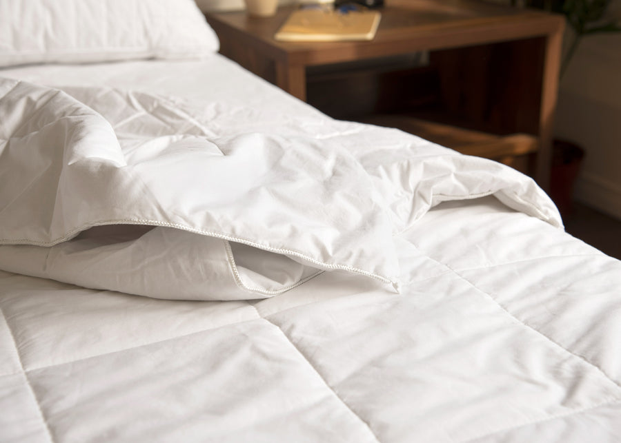 premium white silk duvet corner piping close up