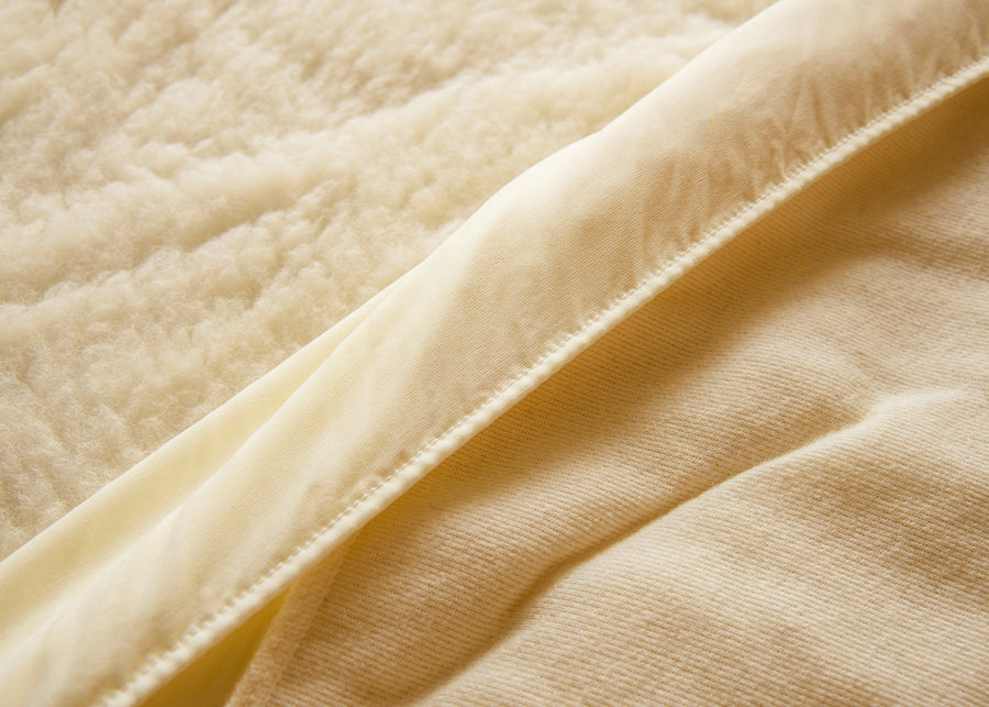 elasticized skirt ivory wool mattress pad