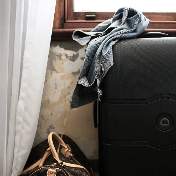 black-delsey-chatelet-leather-trim-luggage