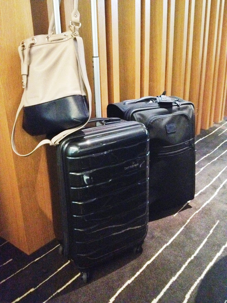 The Spin Trunk, doubling as a handbag hook at the airport