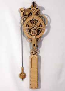 Full front facing view of clock. Displays head, gears, pendulum, and overall design.