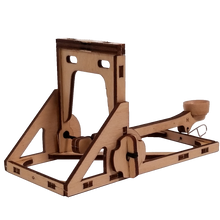 Load image into Gallery viewer, Quarter view of mini catapult ready to aim and fire