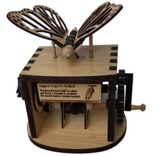 Load image into Gallery viewer, Front facing view of assembled butterfly automaton on white background. Shows one of the butterfly facts that display while cranking wheel.