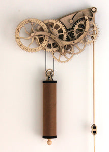 Front facing view of clock & pendulum. Hung on White wall.