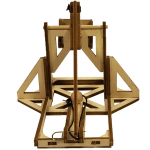 Backside view of assembled mini trebuchet kit. It is knotched and loaded, ready to swing.