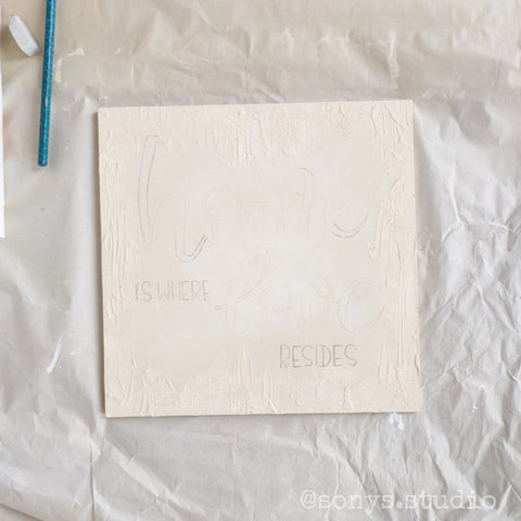 Letters traced very lightly with a pencil